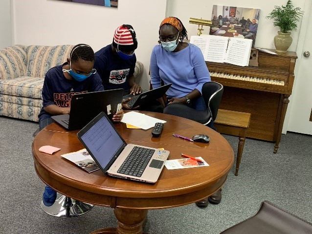 Two high school students learning at the African Resource Center